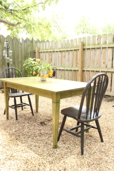 Anne and her refinished furniture in her backyard.